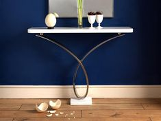 YRON CONSOLE TABLE 03 Mirror polished stainless steel with Thassos marble top and plinth, wall mounted. Dimensions: h900 w1200 d300 Finishes: Mirror polished stainless steel, pewter or antique gold.