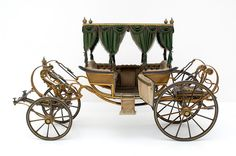 Child's carriage decorated with crowns was the imperial carriage of the Empress Elizabeth of Austria's only son Prince Rudolf, made by the   famous Milanese coachbuilder Cesare Sala in 1860   © Vienna, Kunsthistorisches Museum
