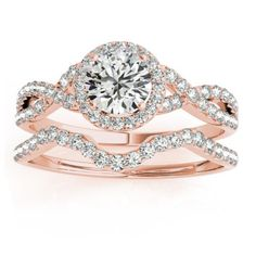 For an exquisite wedding bridal set, this diamond engagement ring setting and matching curved wedding band in 14k Rose (pink) Gold are the perfect rings for her to wear forever.<p>This engagement ring setting has a halo of diamonds and a twisted band design for a radiant look. To complete this setting, your choice of a center stone for mounting is necessary. You can choose from multiple diamond shapes and carats, depending upon your budget and style.<p>This wedding band features diamond…