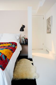 Stacy London's Apartment Is Perfection #refinery29  http://www.refinery29.com/stacy-london-home-tour#slide-13  A bright bedspread balances sweetly against the pale, pinky-peach wall that separates her bedroom from the stairwell.