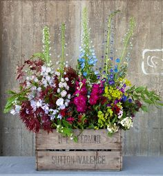 Rebel Rebel naturalistic display in a vintage wooden crate. Captured by Helen Jermyn at New Covent Garden Flower Market.