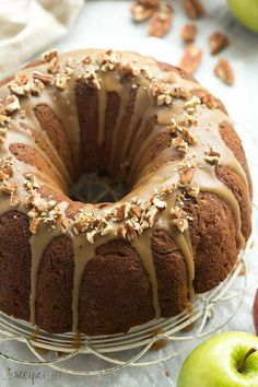 This Praline Apple Bundt Cake is loaded with apples, pecans and covered in a brown sugar praline glaze -- the perfect fall dessert!