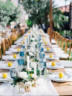 Lemon place cards brightened up the tablescape at this gorgeous outdoor wedding reception. From the chic blue glasses to the white candlesticks lining tables and cascading floral centerpiece, every element of the reception table's were sophisticated chic. Italian Wedding Themes, Italian Theme, Spanish Wedding, Wedding Arbors, Garden Wedding, Wedding Reception, Reception Ideas, Wedding Ideas, Wedding Pics