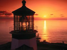 my two favorite things...sunsets & lighthouses:)