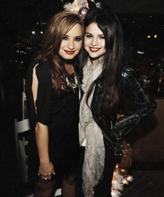 demi lovato staying strong and selena... ;)