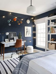 Out of This World: A Kid's Bedroom Gets A Celestial-Inspired Upgrade - Front + Main Kid's Outer Space Bedroom - West Elm . Outer Space Bedroom, Boys Space Bedroom, Boy Room Paint, Boys Room Paint Ideas, Cool Boys Room, Wall Painting For Bedroom, Painting Kids Rooms, Bedroom Ideas Paint, Boys Bed Room Ideas