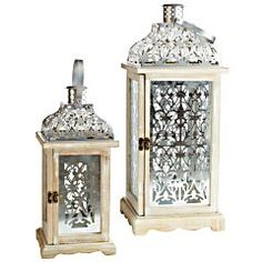 White & Silver Wooden Lanterns  Ornate, hand-painted & designed to withstand outdoor use—yes, it's the official lighting of Winter Wonderland