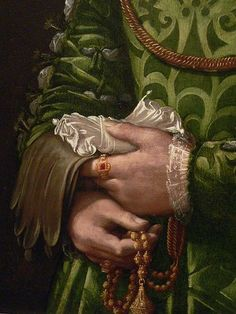 Tudor accessories: Gloves, folded linen or silk handkerchief, and gold girdle with pomander at end