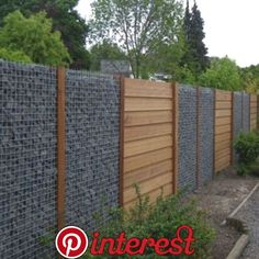 I wonder if the wood portions are removable for a… – Modern Design - Modern Backyard Fences, Garden Fencing, Backyard Landscaping, Fence Design, Garden Design, Garden Retaining Wall, Gabion Wall, Modern Fence, Garden Spaces