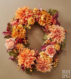 Use this gorgeous floral wreath year after year. A base of red and green foliage makes the orange and gold tones of the flowers and berries pop. For a more personalized wreath, pick your favorite fall flowers as the main wreath decorations. Twig Wreath, Diy Fall Wreath, Autumn Wreaths, Holiday Wreaths, Fall Diy, Floral Wreath, Door Wreaths, Holiday Crafts, Halloween Flower Arrangements