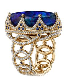 ROYAL RING  18K Yellow Gold ring featuring a 26.11 ct. Black Opal, .58 ctw. of Blue Sapphires, and 2.23 ctw. of Diamonds. Erica Courtney.