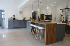 Contemporary Kitchen by Studio 3 kitchens Light coloured maple full length units complement darker island