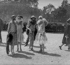 Group of women in summer dresses and fur stoles. Paris, fashion 1925-1928, photographed by Roger-Viollet. Via MessyNessyChic