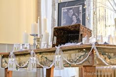 Your wedding guests will want to cozy up to this beautifully draped tablescape. It features whimsical mini-lights, frosty organza ribbon and monogrammed gift bags turned ornaments.