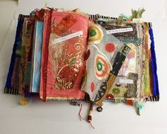fabric journal - good idea to use remnants of all the things I've made the kids over the years (Before I forget)!