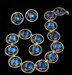 Necklace & Earrings | Los Ballesteros.  Sterling silver with deep, sapphire blue foiled glass cabochons.  ca, pre 1948, Hecho en Mexico.