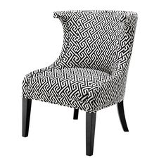 Eichholtz+Elson+Chair+-+Sophisticated+black+and+white+upholstered+dining+armchair+from+Eichholtz. Add+refined+elegance+to+your+interior+style+with+the+Eichholtz+Elson+Chair. Featuring+a+curved+back,+and+black+painted+wooden+legs,+the+contrasting+nickel+stud+detailing+around+the+edge+completes+the+aesthetic. The+simple,+elegant+shape+is+elevated+by+the+charming+monochrome+geometric+pattern,+making+for+the+perfect+focal+point+in+any+dining+setting. Complete+the+look+by+combining+with+other...