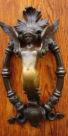 Angel door knocker in Padua, Italy