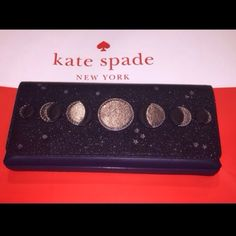 """Kate Spade Moon Clutch Beautiful Kate Spade Lido Avenue Moon Clutch. Dark blue with a glitter finish flap adorned with different moon phases and stars.  Magnetic snap tabs hold the flap closed. Interior is lined with blue Kate Spade fabric and has a multi function slip pocket on one side. 10"""" x 4.5"""" x 1.25""""    NWOT  No Trades kate spade Bags Clutches & Wristlets"""