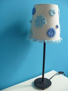 Lampshade with crocheted motifs