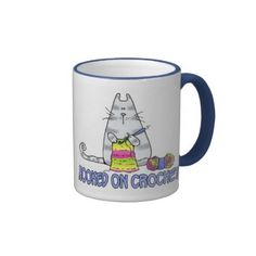#Crochet                                        hooked on crochet coffee mug                   All crochet fanatics and yarnaholics - here's a design to add to your collection. This crocheting kitty with her ball of wool shares your obsession. A Corrie Kuipers Original
