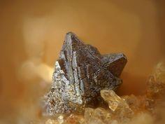 Clinobisvanite,  BiVO4,  Finding Point 14.0, Hohenstein, Reichenbach, Bensheim, Odenwald, Hesse, Germany. Fov 1.5 mm. Copyright Stephan Wolfsried
