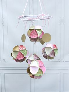 A personal favorite from my Etsy shop https://www.etsy.com/listing/258249284/pink-gold-mint-baby-mobile-paper-baby
