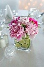 Here's another fabulous DIY wedding flower arrangement simply but stunningly done with peonies and slices of lime. Peony blooms are a little bit more expensive than gerbera daisies, but this DIY wedding arrangement is still extremely budget friendly. The limes are held in place with floral foam, which is also used to place the peonies into for stability.