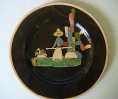 Sweet little black Tlaquepaque plate on Ebay!  http://cgi.ebay.com/ws/eBayISAPI.dll?ViewItem&item=380676861275&ssPageName=STRK:MESE:IT#ht_660wt_967