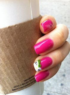 Have fun with this minimalist inspired Hello Kitty nails. The nails are painted in matte dark pink color and a lone Hello Kitty French tip is added. The Green bow is then placed at the top to grab attention and make noise away from the rather warm nail design.