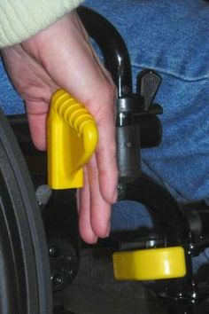 Accu-Grips Wheelchair Grips. The Accu-Grips are much-needed, state-of-the art wheelchair grips that replace the existing leg rest and wheel lock grips on manual wheelchairs. The unique design and bright yellow color enable wheelchair users and their caregivers to more readily locate the grips. Pinned by ottoolkit.com your source for geriatric occupational therapy resources.