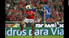 Benfica's Eduardo Salvio, left, heads the ball to score the opening goal past Porto's Alex Sandro during a Portugal Cup semifinal second leg...