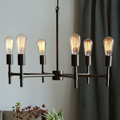 Industrial Chandelier #westelm $249 - This could be cool over the game table.  I think if you are going to do a game table then the light could be a little bit more of a statement and there is not much ambient light in the room to start with.