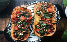 The chickpeas in this stuffed squash are cooked with delicious warming spices, mushrooms, bell peppers, and Chinese long beans, which are absolutely optional.