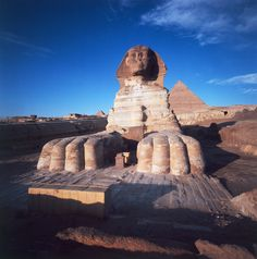 Giza, front view of the Sphinx with the Great Pyramid of Khafra in background.