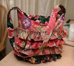 The Project Princess Strikes Again: Ruffle Bag V2.0: The Fat Quarter Bag  This little purse just screams Summertime. Change the fabric and it could scream Chrismas, or any other holiday season.