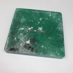 Our coasters are one of a kind. You won't find two the same and can be purchased as a one off piece. This gorgeous green coaster can be yours for only £5. #coaster #resincoaster #cupcoaster #coasters #marble #greenmarbleeffect #handmade #paintsplatter #oneofakind #coffeecoasters #tablecoasters Coffee Coasters, Table Coasters, Cup Coaster, Marble Effect, Paint Splatter, Plastic Cutting Board, Unicorn, Green, Handmade