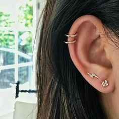 I like the rings at the top of her ear