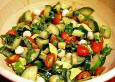 Cucumber-Avocado Caprese Salad: Made with diced cucumbers, cherry tomatoes, fresh basil leaves, avocado, balls of fresh mozzarella, and tossed with homemade balsamic vinaigrette, this cucumber-avocado caprese salad makes a refreshing post-workout snack.