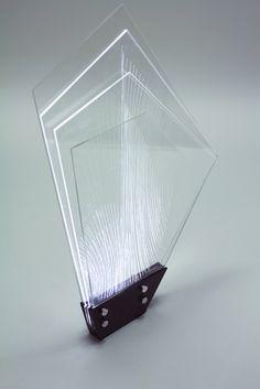 -lighting- Nautilus light, 2012    360x520x40 mm  acril, LED, steel