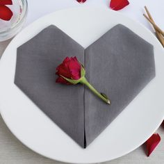 This napkin folded in heart shape is a simple and beautiful way to set the table for a wedding, Valentine's Day and Mother's Day.