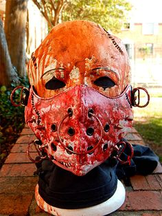 Mask human may use for disguise, covered in blood due to killing zombies.
