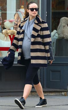 The pregnant star headed home after a morning trip to the gym in a striped blue and beige coat.