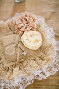 shabby burlap and lace ring pillow with rosettes