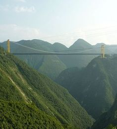 China has repeatedly bested itself and others for the title of world's tallest bridge, but the highest one yet, and the current reigning champ is the Sidu River Bridge which hangs over 1,600 nauseating feet above a canyon floor, connecting what amounts to two mountaintops.
