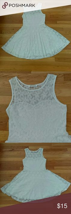 White Lace Dress! Very pretty white lace dress. Has a lining so it is not see through at all. I wore this dress but there are no stains. There are belt loops so you can wear with a belt but it does not come with one. Perfect for the spring and summer! Glamorous Dresses