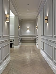 grey panelling, parquet flooring. oak floor. porta romana lighting. kibre ltd