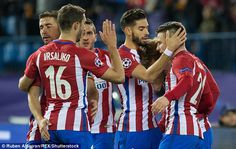 Atletico Madrid players celebrate Kevin Gameiro's opener against PSV Eindhoven...