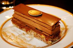plaisirs sucres    Almond meringue sandwich cake with crushed hazelnuts, crusty praline, thin milk chocolate leaves, Chantilly cream and milk chocolate filling