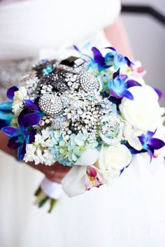 Brooch Bouquet with touches of blue floral.  Photo: Orange Soda Photography